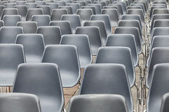 Empty blu plastic chairs Royalty Free Stock Photo