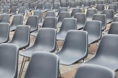 Empty Blu Plastic Chairs