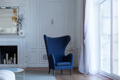 Empty blue armchair in classical interior Royalty Free Stock Photography