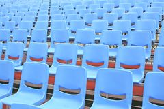 Empty Blue Bleachers. In an open air environment royalty free stock photography