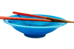 Empty blue bowl with chopsticks on white background Royalty Free Stock Images