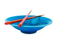 Empty blue bowl with chopsticks on white background Stock Photography