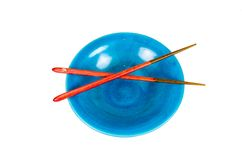 Empty blue bowl with chopsticks on white background Royalty Free Stock Photography