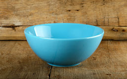 Empty blue bowl on the wooden background Royalty Free Stock Image