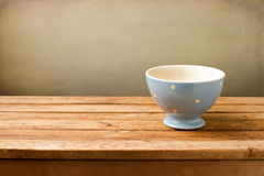 Empty blue bowl on wooden table Royalty Free Stock Photo