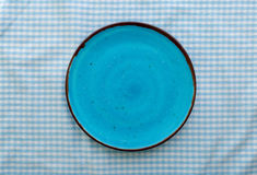 Empty blue ceramic plate close up, top view Royalty Free Stock Photos