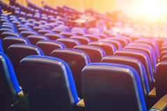 Empty blue chairs at cinema or theater or a conference room.  Stock Images
