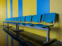 empty blue chairs on the floor Royalty Free Stock Images