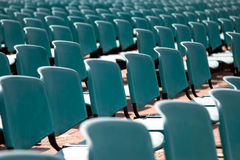 Empty blue chairs Stock Images
