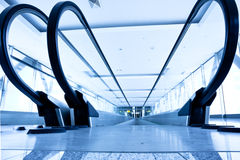 Empty  blue escalator Stock Images