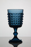 Empty blue glass on white background Stock Photography