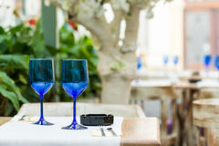 Empty Blue Glasses On Restaurant Table Stock Photo