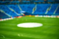Empty blue green football soccer field stadium. Soft focus blurred background.  Stock Images