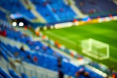 Empty blue green football soccer field stadium. Soft focus blurred background.  Royalty Free Stock Image
