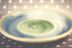 Empty blue and green plate on pink dotted background. Stock Photos