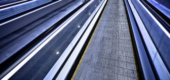 Empty blue moving escalator Stock Photo