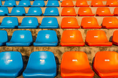 The empty blue and orange stadium seat. Royalty Free Stock Photography