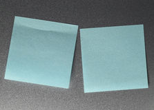Empty blue paper sheet on refrigerator door. Royalty Free Stock Image