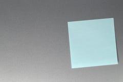 Empty blue paper sheet on refrigerator door. Stock Photo