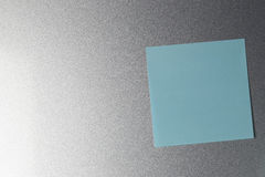 Empty blue paper sheet on refrigerator door. Royalty Free Stock Photography