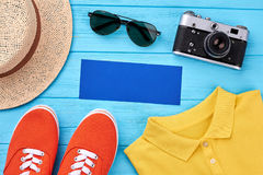 Empty blue paper, summer accessories. Essential items for summer trip Royalty Free Stock Photography