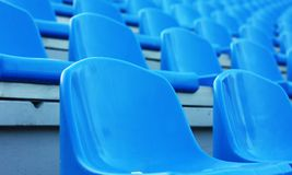Empty blue plastic stadium seats Royalty Free Stock Photo
