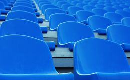Empty blue plastic stadium seats Royalty Free Stock Image