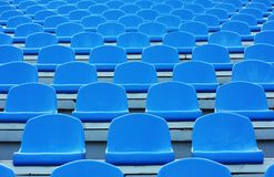 Empty blue plastic stadium seats Royalty Free Stock Photos