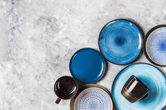 Empty Blue Plates on Grey Background royalty free stock photography