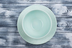 Empty blue plates over wooden table Stock Photography
