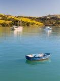 Empty blue rowing boat Akaroa Harbor Stock Photo