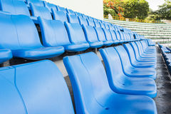 Empty blue seats or chair rows in stadium Stock Photos