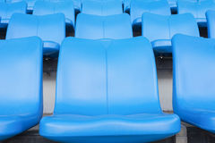 Empty blue seats or chair rows in stadium Royalty Free Stock Images
