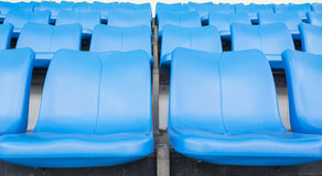 Empty blue seats or chair rows in stadium Royalty Free Stock Photo