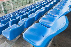 Empty blue seats or chair rows in stadium Stock Image