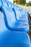 Empty blue seats or chair rows in stadium Royalty Free Stock Photography