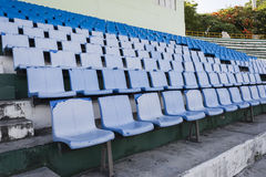 Empty blue seats or chair rows in stadium Stock Photo
