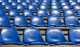 Empty blue seats at sports stadium Royalty Free Stock Photo