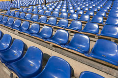 Empty blue seats at sports stadium Royalty Free Stock Images