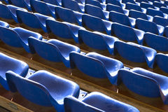 Empty blue seats at sports stadium Royalty Free Stock Image
