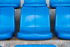 Empty blue seats in stadium Stock Image