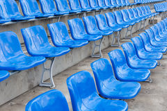 Empty blue seats in stadium Stock Photos