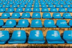 The empty blue stadium seat. Stock Photos