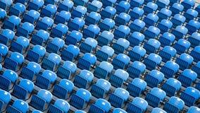 Empty blue stadium seats Stock Photos
