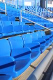 Empty blue stadium seats Stock Photos