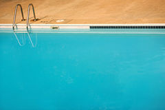 Empty blue swimming pool. Plain simple background of an empty blue swimming pool with plenty of copyspace stock photos