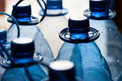 Empty, blue water bottles for recycle. Close up shot on natural harsh light Stock Photos