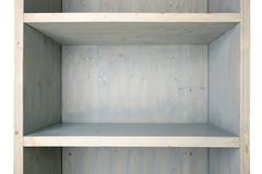 Empty blue wooden shelf isolated on white background. Wood shelf cupboard with grunge aging surface stock image