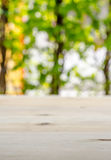 Empty blur wooden desk and blur natural background Royalty Free Stock Photos