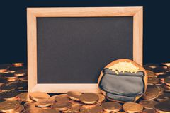 Empty board with golden coins and icing cookie, st patricks day concept royalty free stock photography